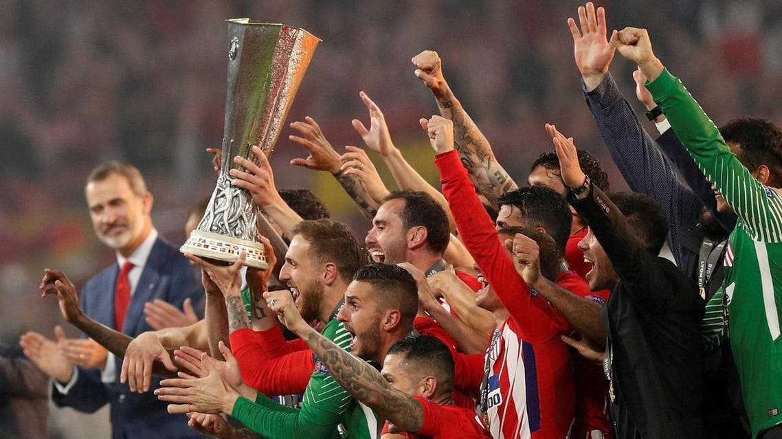 Atletico Madrid celebrate with the trophy after winning the Europa League. (Reuters)