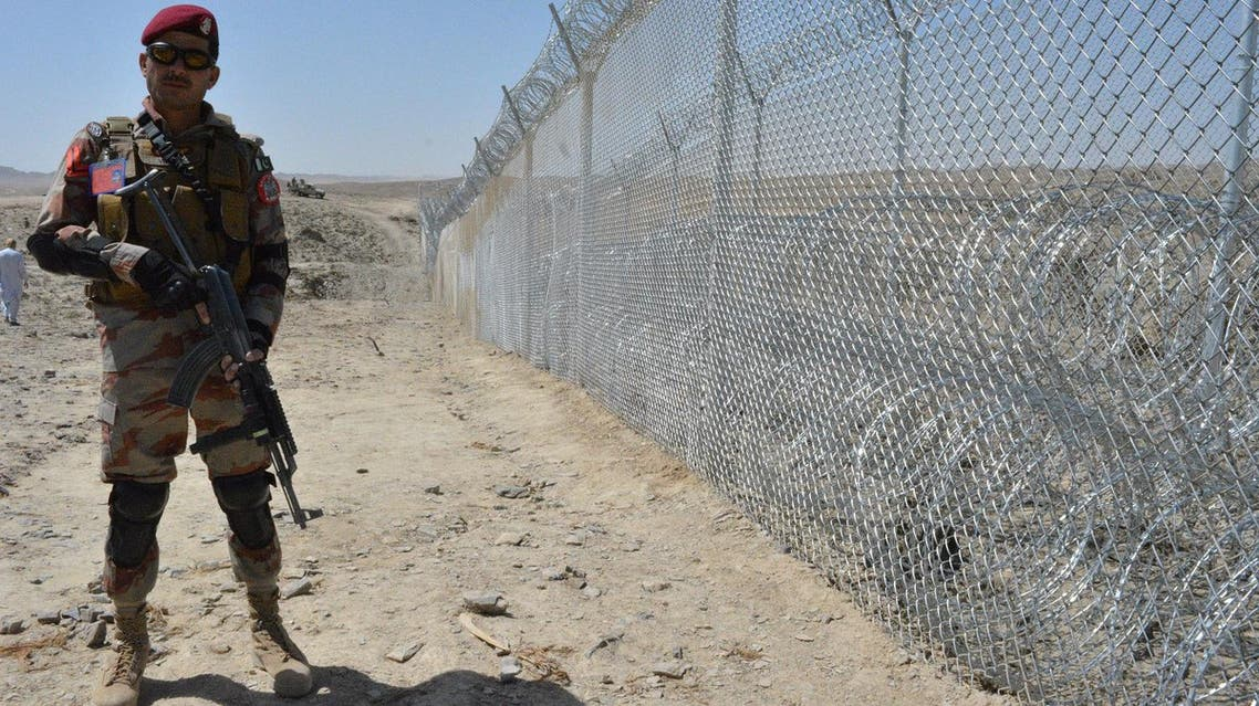 A Pakistani army soldier stands guard along with border fence at the Pak-Afghan border near the Punjpai area of Quetta in Balochistan on May 8, 2018. (AFP)