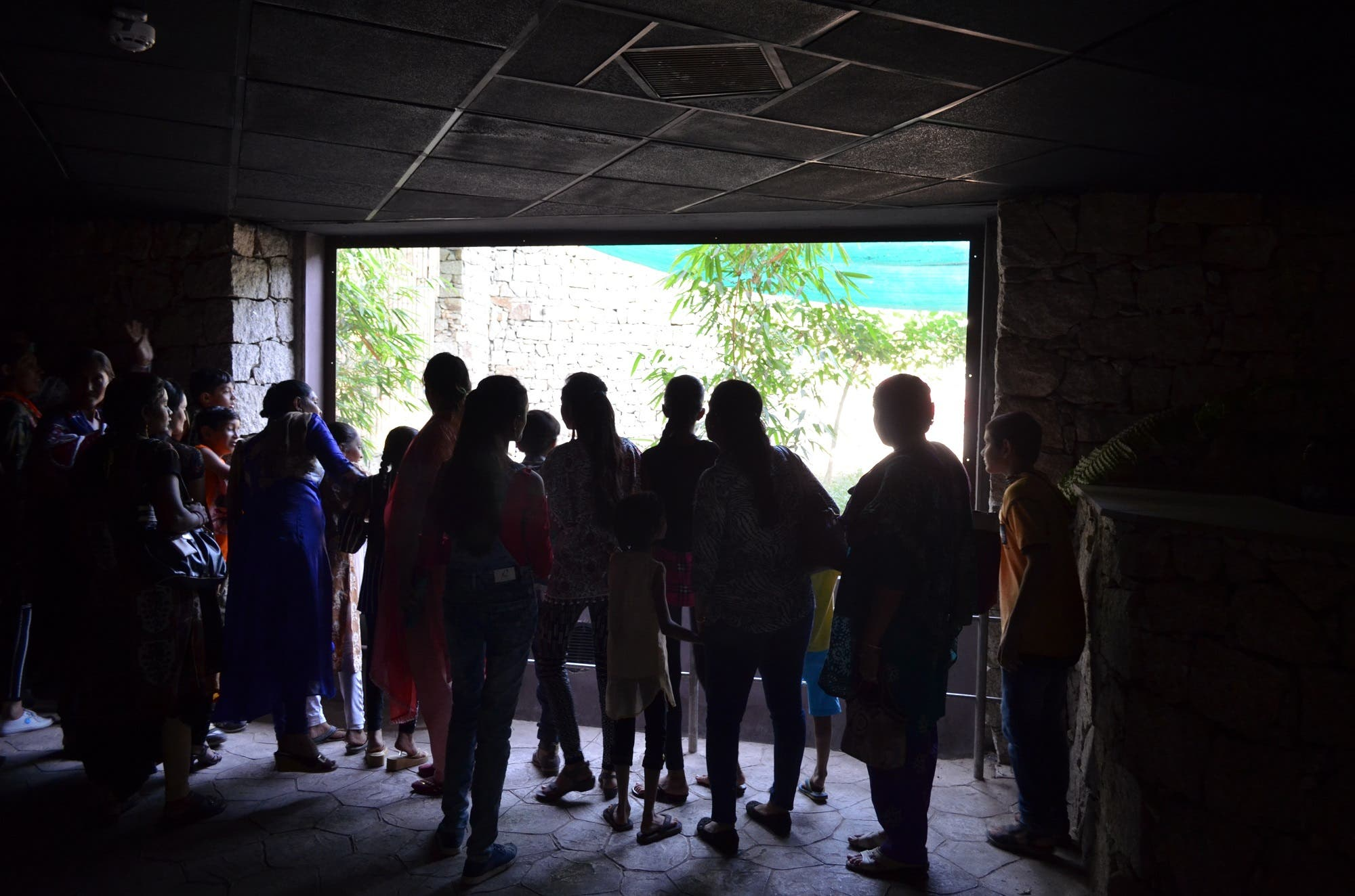 Visitors watch though gigantic glass enclosures in a cave in the nocturnal zoo. (Supplied)