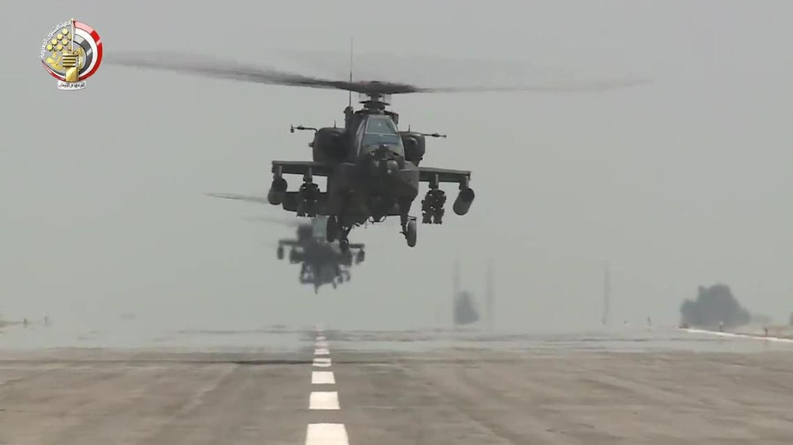 An image grab taken from a handout video released by the Egyptian Defence Ministry on November 25, 2017 shows US-made Egyptian army Apache attack helicopters flying from an airfield. (AFP)