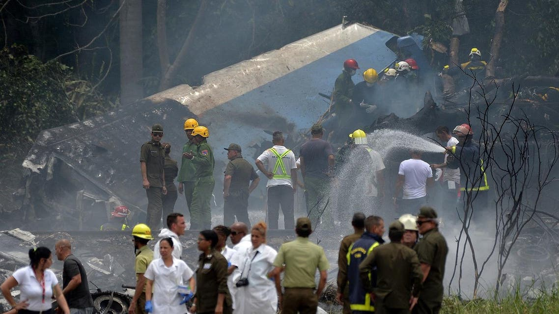 Emergency personnel work at the site of the accident after a Cubana de Aviacion aircraft crashed after taking off from Havana's Jose Marti airport on May 18, 2018. (AFP)