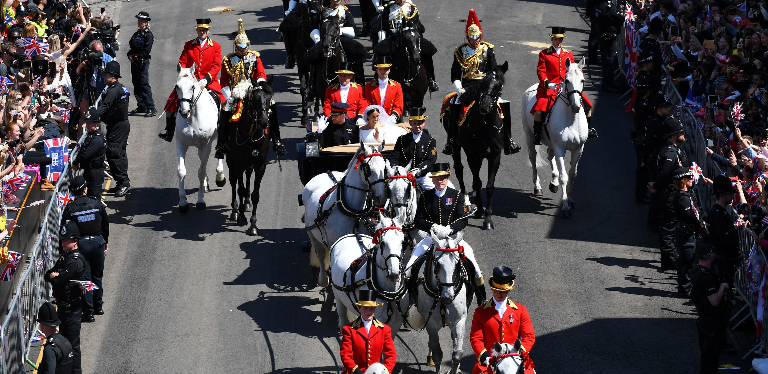 Prince Harry and his wife Meghan Markle ride a horse-drawn carriage after their wedding ceremony at St George's Chapel in Windsor, Britain, May 19, 2018. REUTERS/Dylan Martinez