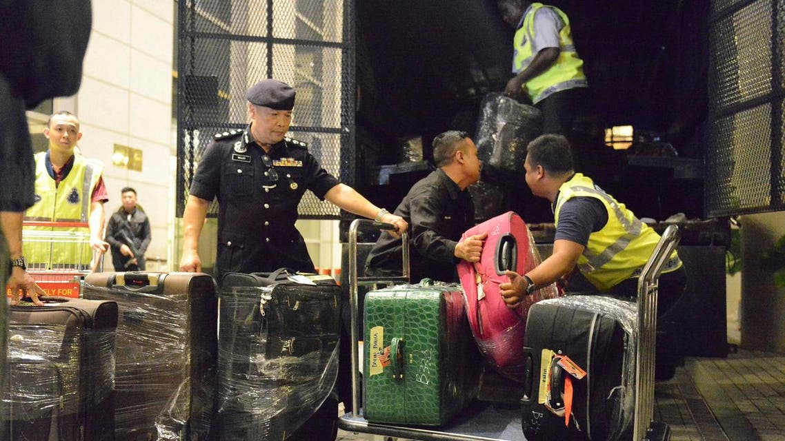 Police load confiscated items into a truck in Kuala Lumpur, on  Friday, May 18, 2018. Malaysian police confiscated a few hundred designer handbags and dozens of suitcases containing cash, jewelry and other valuables as part of a corruption and money-laundering investigation into former Prime Minister Najib Razak. (AP)