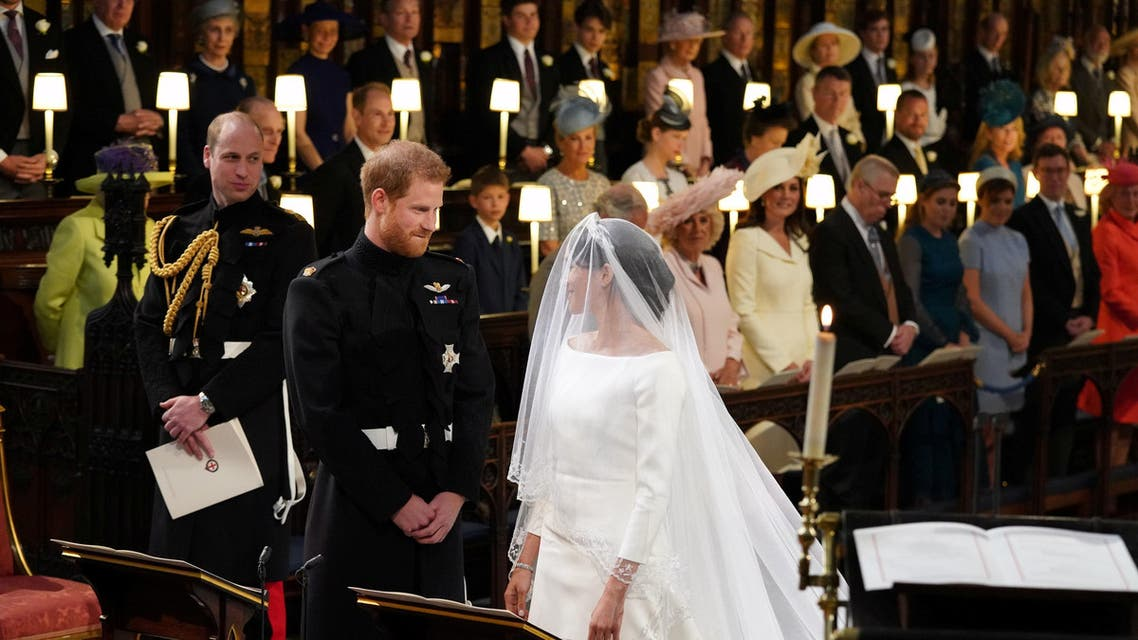 Prince Harry looks at his bride, Meghan Markle, as she arrives accompanied by the Prince of Wales in St George's Chapel at Windsor Castle for their wedding in Windsor, Britain, May 19, 2018. Jonathan Brady/Pool via REUTERS