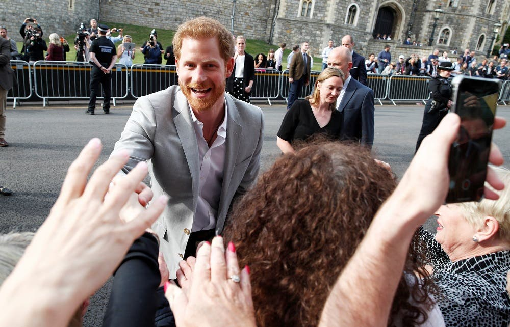 Britain's Prince Harry greets wellwishers outside Windsor Castle ahead of his wedding to Meghan Markle tomorrow, in Windsor, Britain, May 18, 2018. REUTERS/Damir Sagolj
