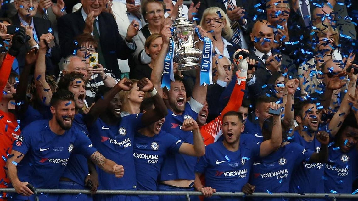 Chelsea's Gary Cahill lifts the trophy as they celebrate winning the FA Cup. (Reuters)