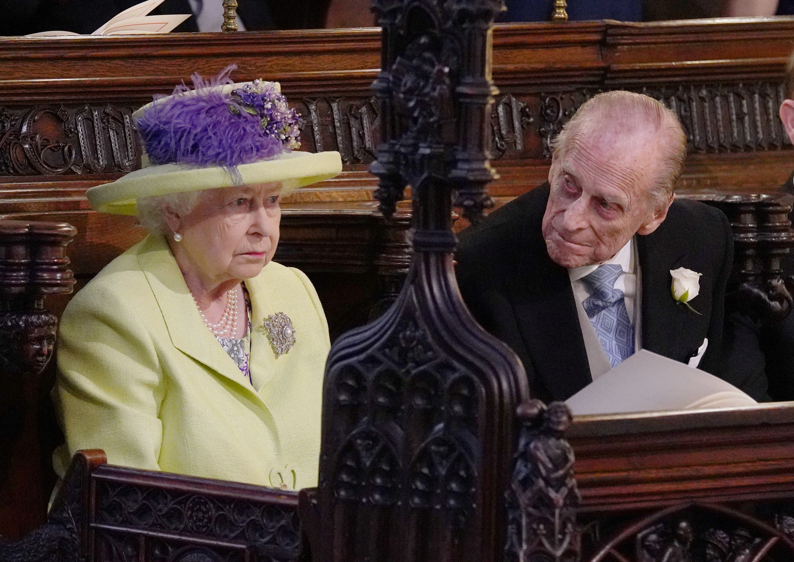 Queen Elizabeth II and Prince Phillip during the wedding service for Prince Harry and Meghan Markle at St George's Chapel, Windsor Castle in Windsor, Britain, May 19, 2018. Jonathan Brady/Pool via REUTERS
