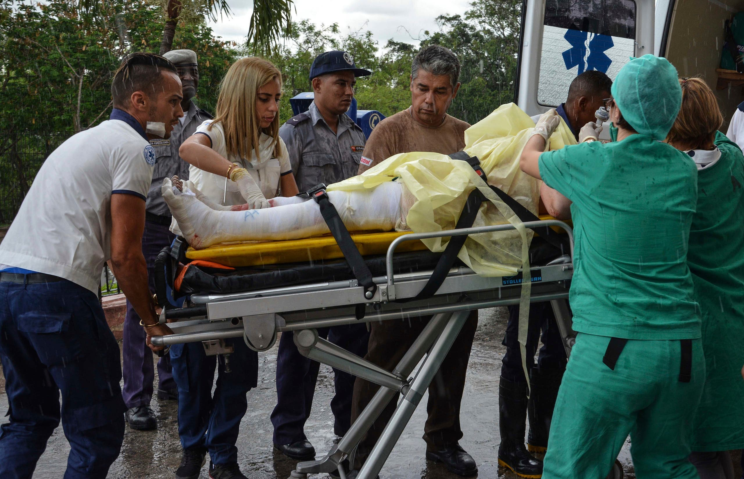 The few surviving passengers of an airliner that crashed arrive at the Calixto Garcia General Hospital in Havana, Cuba, Friday, May 18, 2018. The 39-year-old airliner with 110 people aboard crashed and burned in a cassava field just after takeoff from the Havana airport, leaving three survivors in Cuba's worst aviation disaster in three decades, officials say. (Marcelino Vazquez Hernandez/ACN via AP)