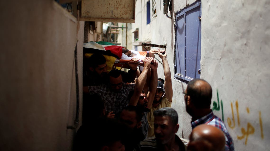 ATTENTION EDITORS - VISUAL COVERAGE OF SCENES OF INJURY OR DEATH Mourners carry the body of Palestinian Moein Al-Saian, who died of wounds he sustained during a protest at the Israel-Gaza border, during his funeral in Gaza city May 19, 2018. REUTERS/Mohammed Salem