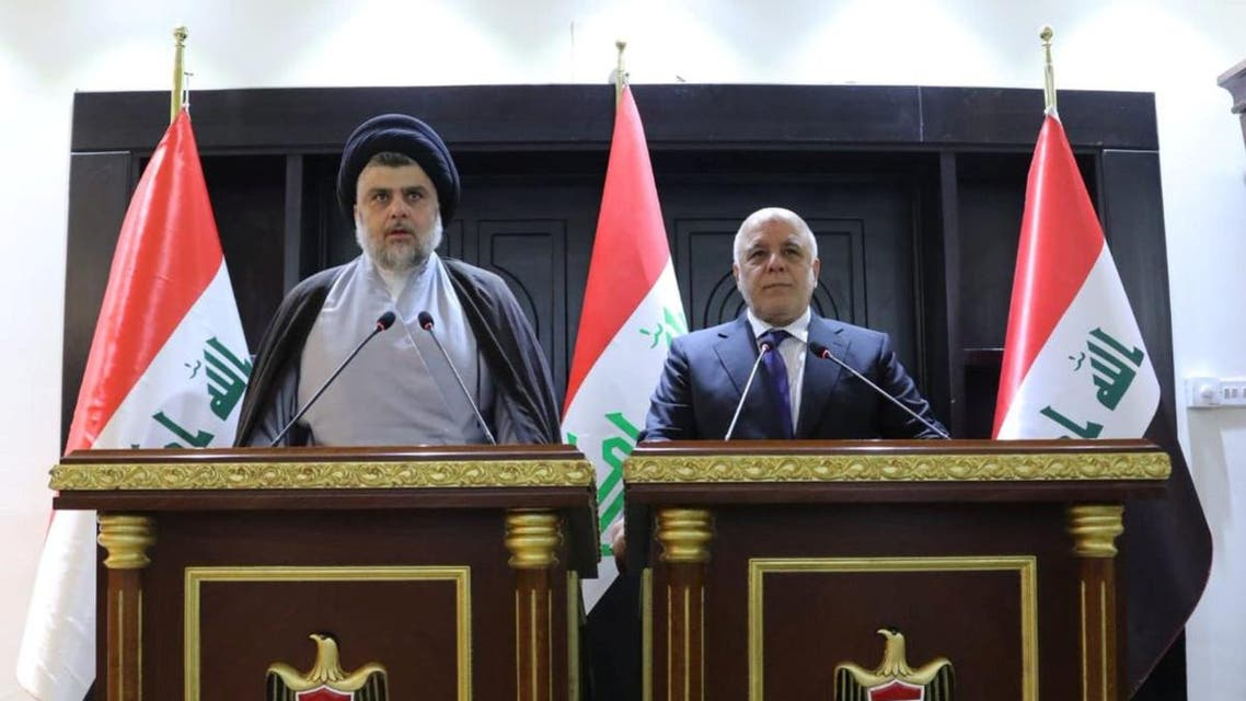 Iraqi Shiite cleric Moqtada al-Sadr speaks during a news conference with Iraqi Prime Minister Haider al-Abadi. (Reuters)