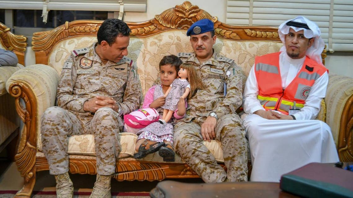 Coalition hands Yemeni government infant girl used as human shield by Houthis. (SPA)