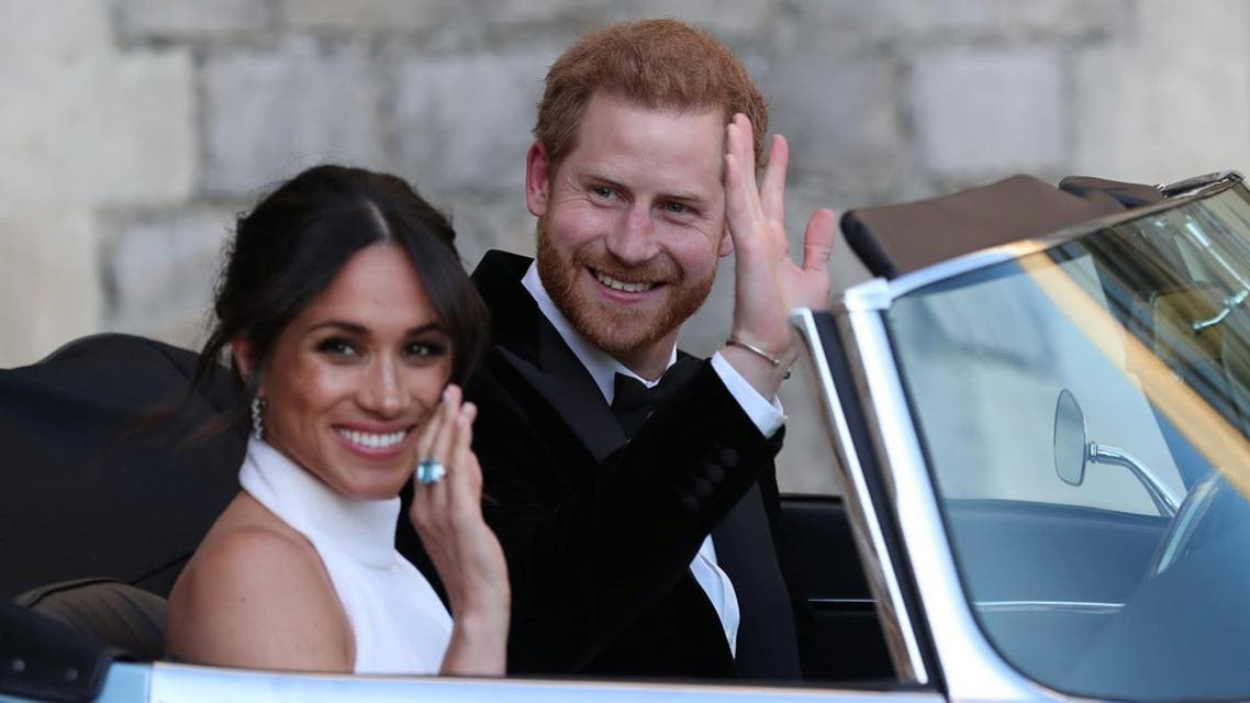 The newly married Duke and Duchess of Sussex, Meghan Markle and Prince Harry, leaving Windsor Castle after their wedding to attend an evening reception. (Reuters)