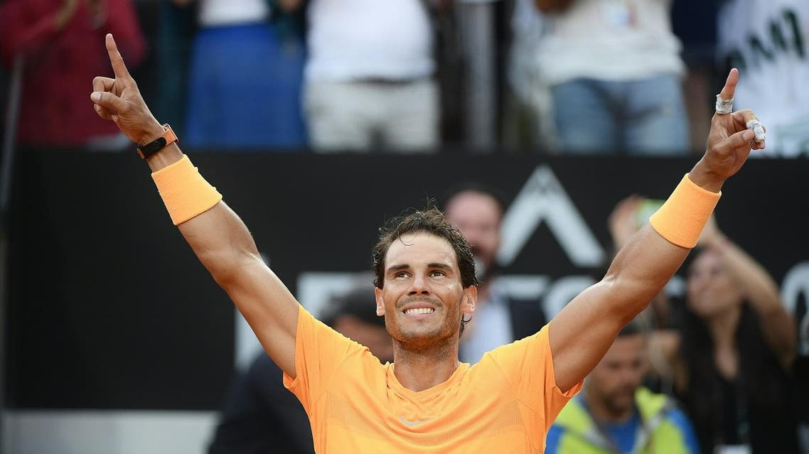 Rafael Nadal celebrates after winning the Men's final against Alexander Zverev at Rome's ATP Tennis Open tournament at the Foro Italico, on May 20, 2018. (AFP)