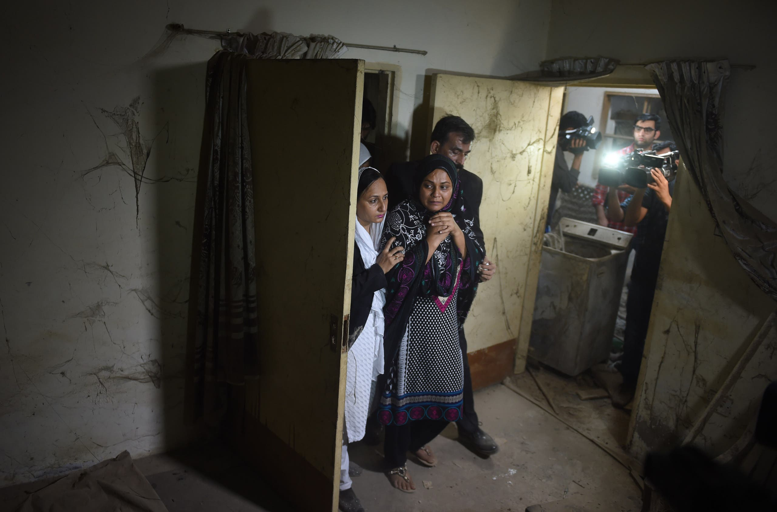 Asma Nawab visitin her lotted family home. (AFP)