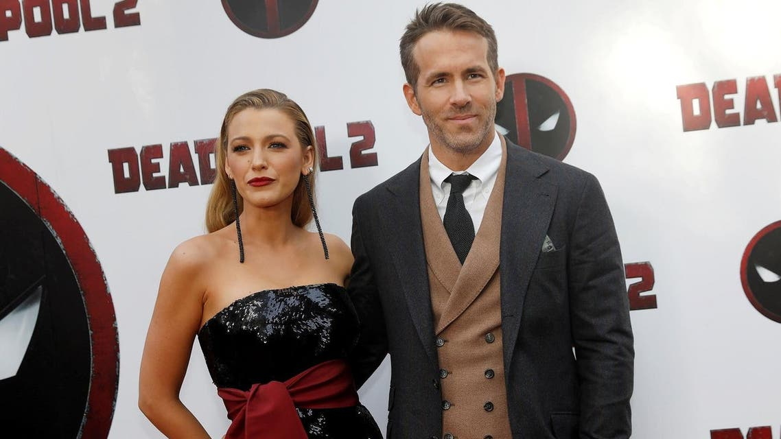 """Actor Ryan Reynolds and his wife Blake Lively pose on the red carpet during the premiere of """"Deadpool 2"""" in Manhattan, New York, on May 14, 2018. (Reuters)"""