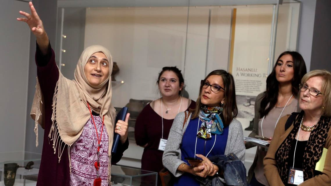 Moumena Saradar (left), originally from Syria, guides visitors through the Middle East gallery at Penn Museum, in Philadelphia. (AP)