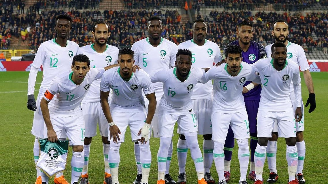 Saudi players pose for a team group photo before their friendly game against Belgium. (Reuters)
