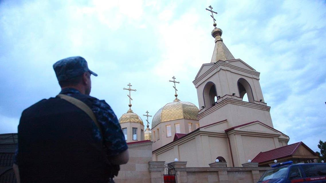 A policeman stands guard at Archangel Michael Church in Grozny, Russia. (AP)