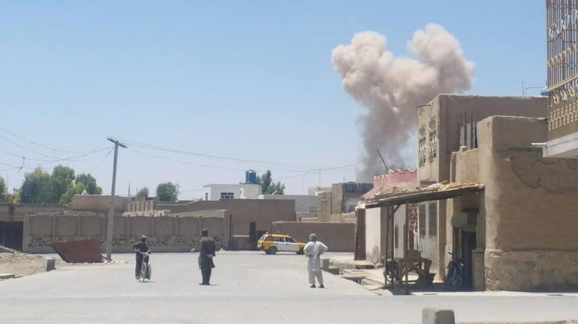 A cloud of smoke seen after an explosion in Kandahar on May 22, 2018 in this picture obtained from social media. (Reuters)