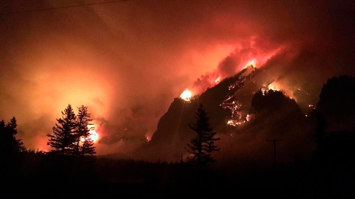 The fire caused evacuations, an extended shutdown of a major interstate highway and devastation to a major outdoor tourist attraction. (AP)