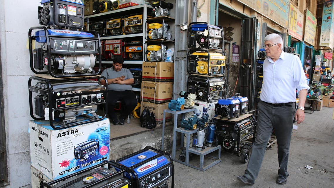 An Iraqi man shops at a store selling power generators in Baghdad on April 7, 2018.