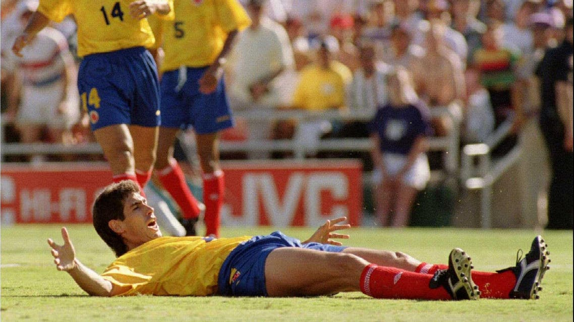 Andres Escobar lays on the pitch after hitting the ball into his own net in match against the United States at the Rose Bowl June 22, 1994. (Reuters)