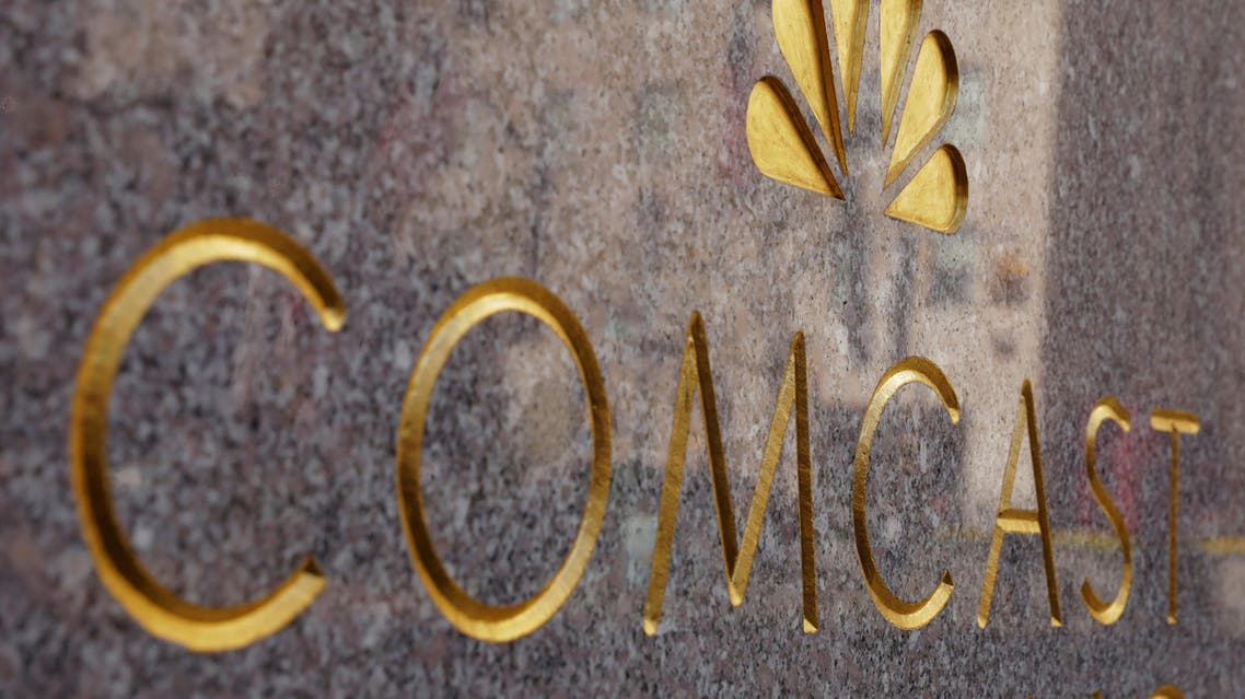 The NBC and Comcast logos are displayed on 30 Rockefeller Plaza in midtown Manhattan in New York, U.S., February 27, 2018. REUTERS/Lucas Jackson