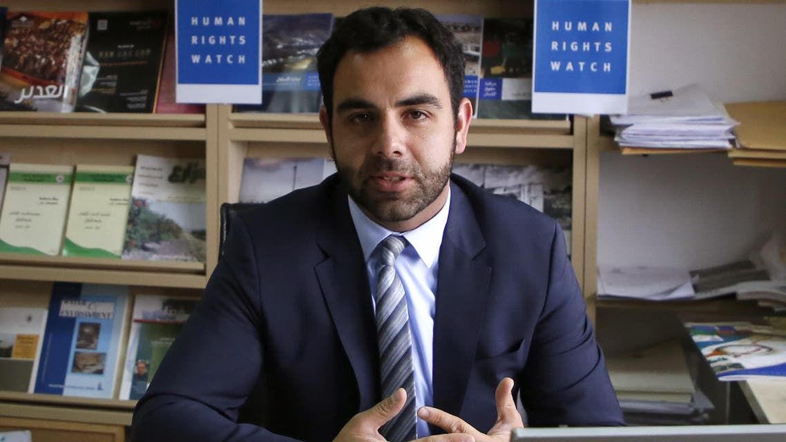 Human Rights Watch's Israel and Palestine director Omar Shakir, a US citizen, sits at his office in the West Bank city of Ramallah on May 9, 2018. Israel has given the Human Rights Watch director two weeks to leave the country, accusing him of promoting a boycott, in a move the rights group said sought to muzzle criticism. ABBAS MOMANI / AFP