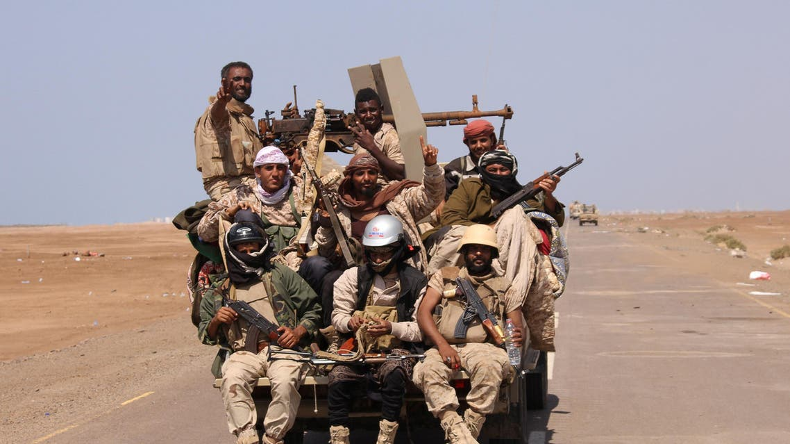 Members of the Yemeni army ride on the back of a military truck near the Red Sea coast city of al-Mokha. (Reuters)