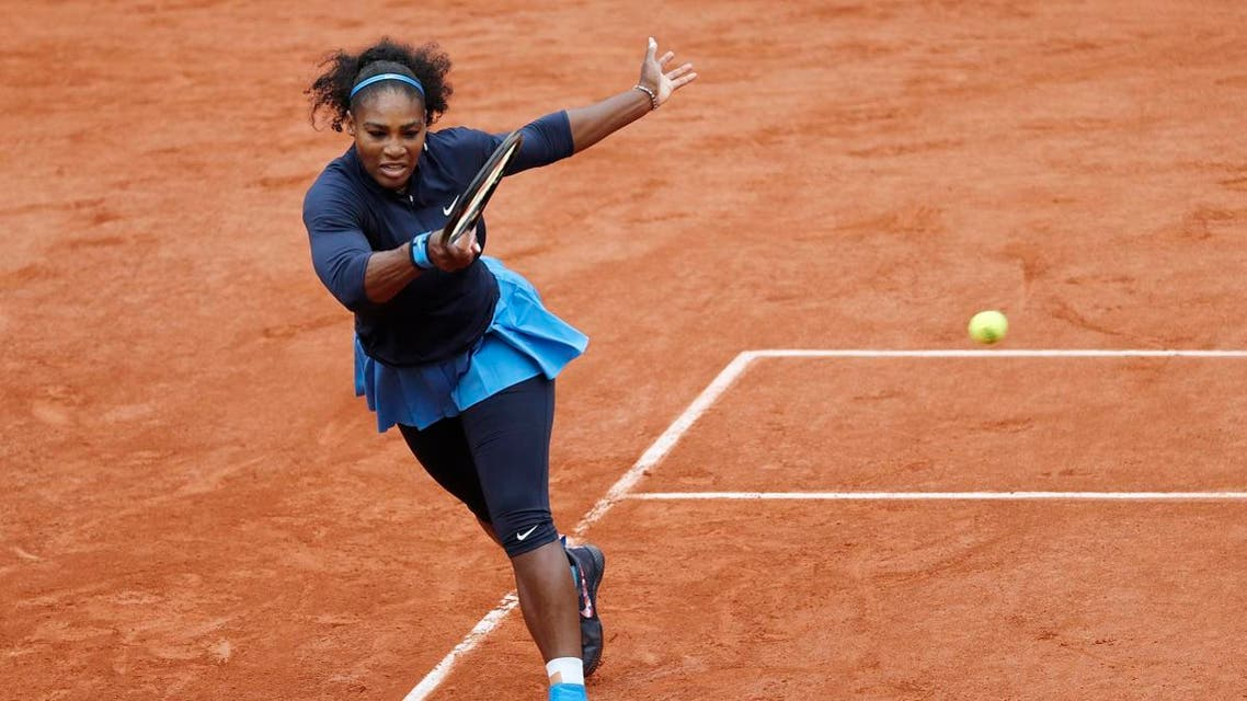 Serena Williams returns the ball to Spain's Garbine Muguruza during their women's final match at the Roland Garros 2016 French Tennis Open in Paris on June 4, 2016. (AFP)