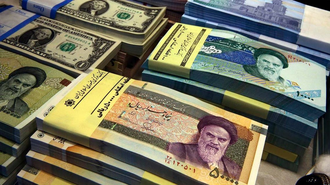 Iranian and US banknotes are on display at a currency exchange shop in downtown Tehran, Iran. (AP)