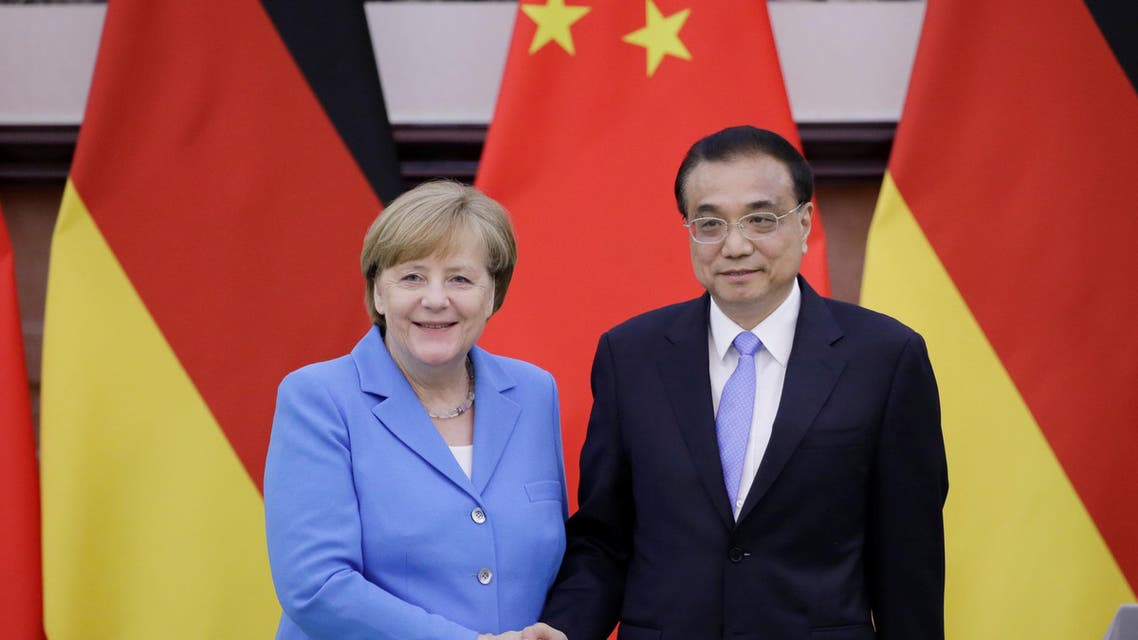 China's Premier Li Keqiang (R) shakes hands with German Chancellor Angela Merkel after a joint news conference at the Great Hall of the People in Beijing. (Reuters)