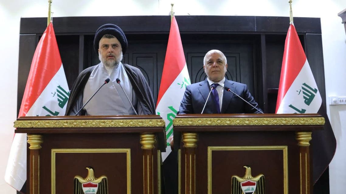 Iraqi Shi'ite cleric Moqtada al-Sadr (L) speaks during a news conference with Iraqi prime Minister Haider al-Abadi in Baghdad, Iraq May 20, 2018. Iraqi Prime Minister Media Office/Handout via REUTERS ATTENTION EDITORS - THIS IMAGE WAS PROVIDED BY A THIRD PARTY. NO RESALES. NO ARCHIVES