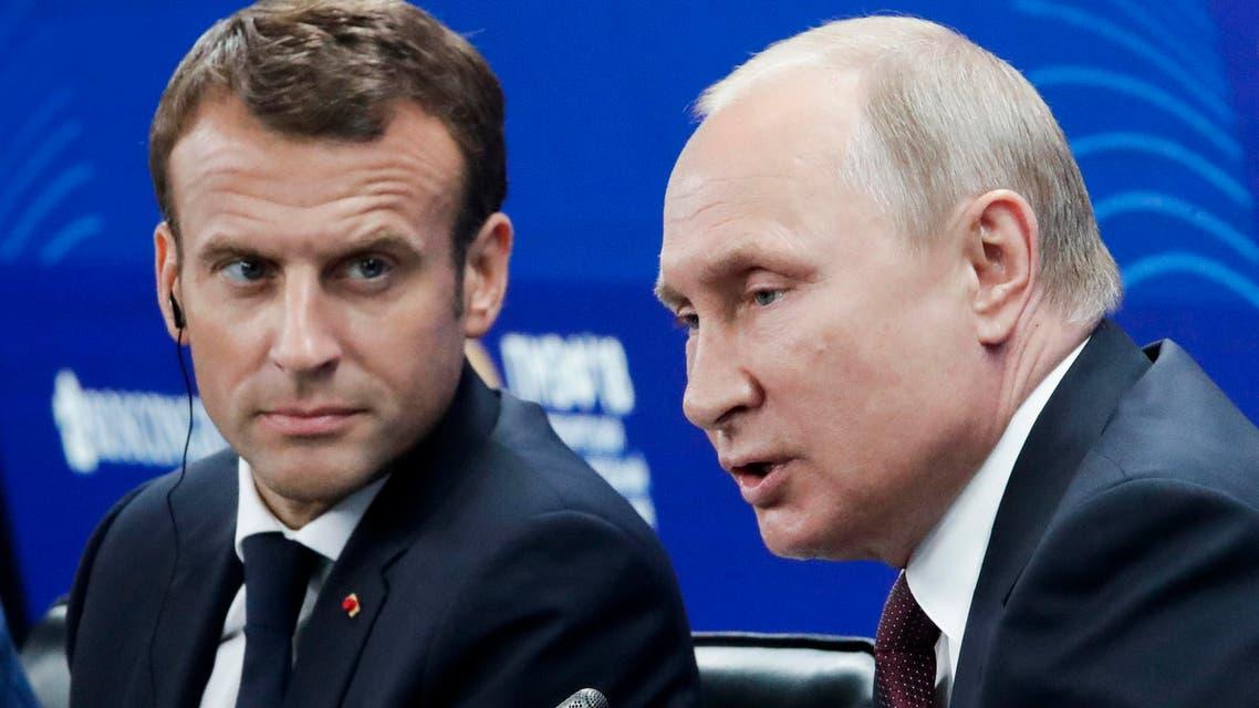 Putin and Macron (AFP)