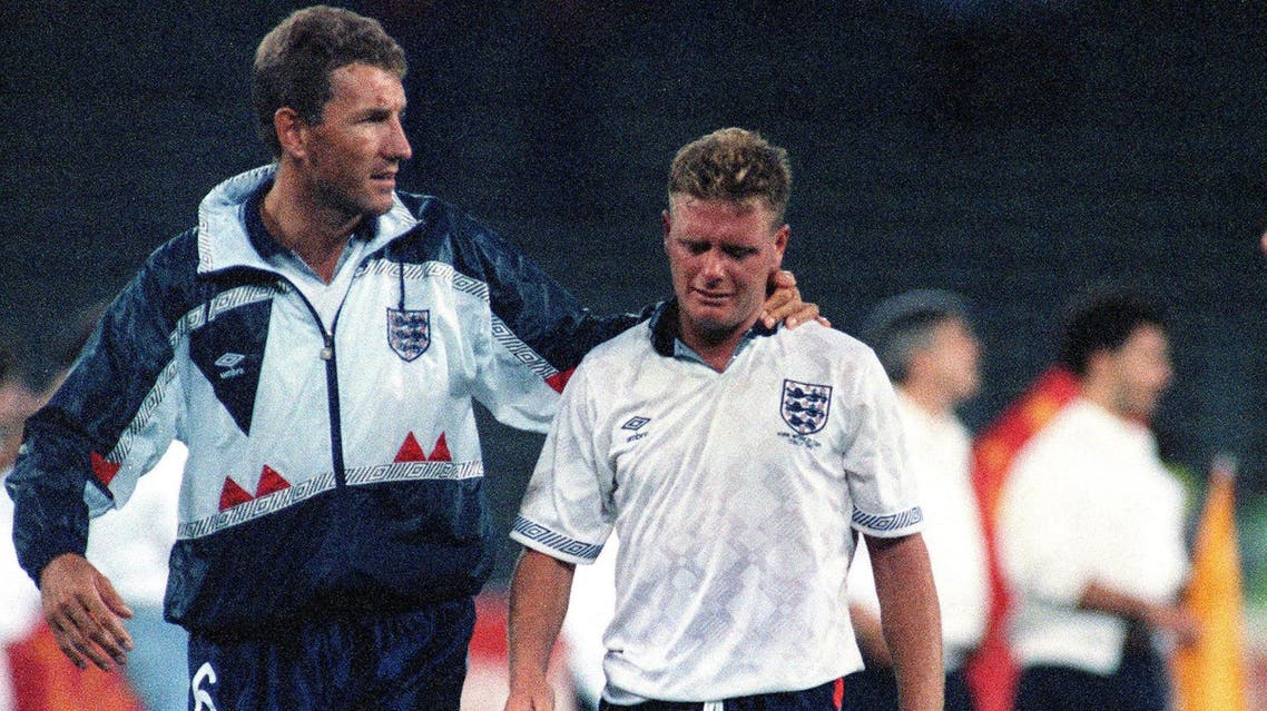 The July 4, 1990 file photo shows Gascoigne crying as he is escorted off the field by team captain Terry Butcher. (AP)
