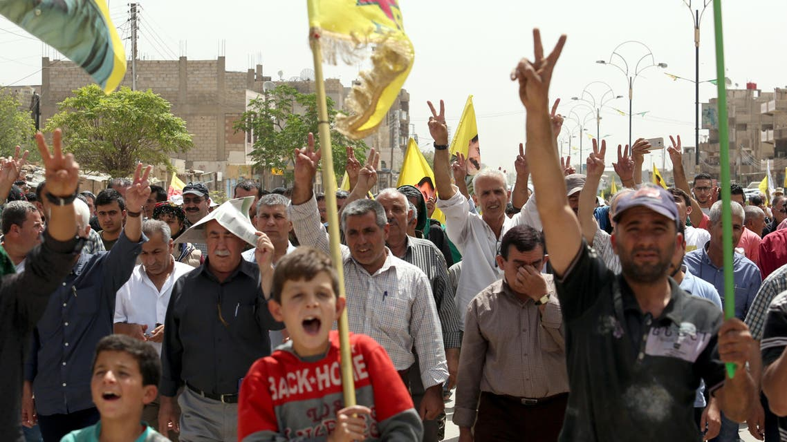 Syrian-Kurdish people demonstrate against demographic changes forced by Turkey to repopulate Kurdish areas, in Qamishli on May 26, 2018. Delil souleiman / AFP