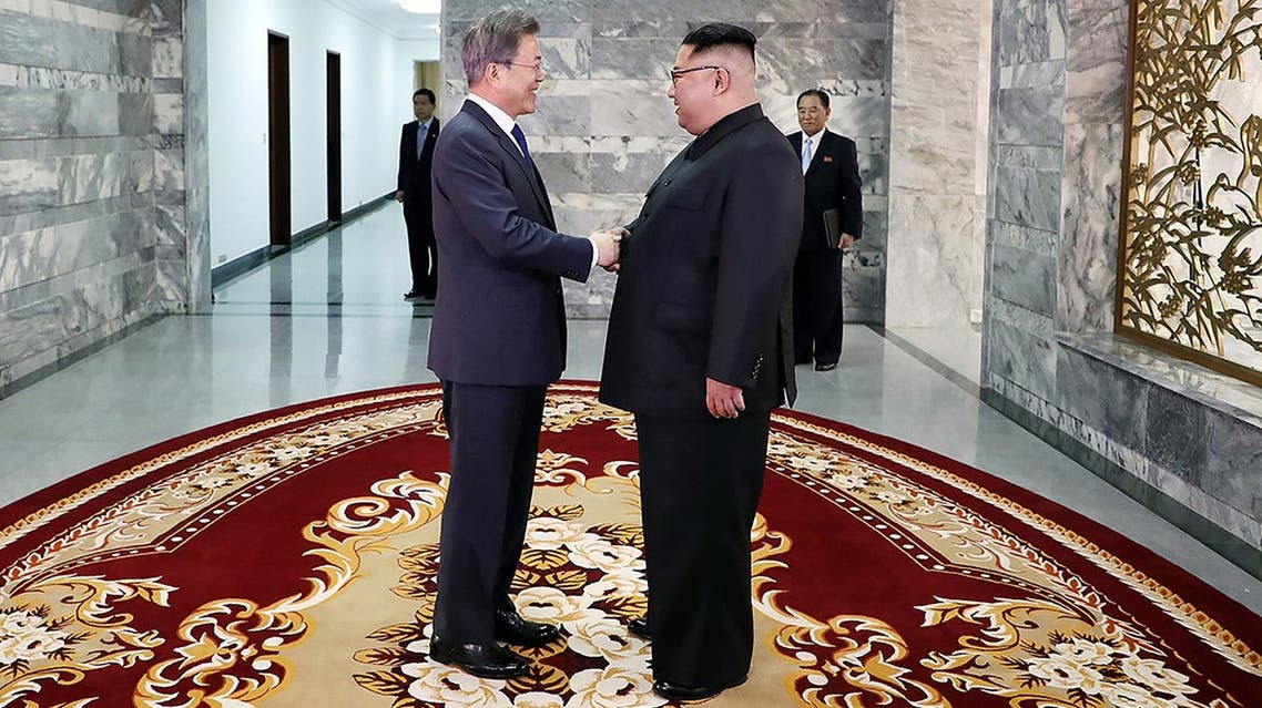 This handout from the Blue House taken and released on May 26, 2018 shows South Korea's President Moon Jae-in (L) shaking hands with North Korea's leader Kim Jong Un before their second summit at the north side of the truce village of Panmunjom in the Demilitarized Zone (DMZ). (AFP)