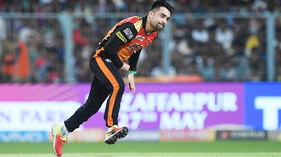 Sunrisers Hyderabad cricketer Rashid Khan bowls during the 2018 Indian Premier League(IPL) Twenty20 second Qualifier cricket match against Kolkata Knight Riders at The Eden Gardens Cricket Stadium in Kolkata on May 25, 2018. (AFP)