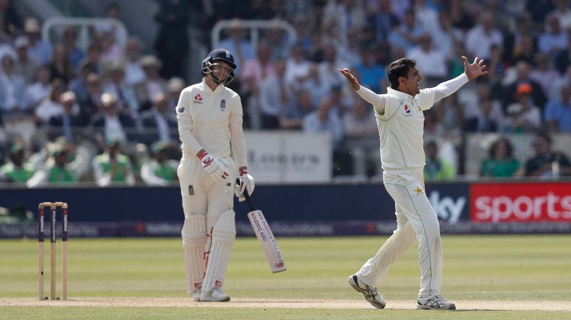 Pakistan's Mohammad Abbas (R) appeals successfully to take the wicket of England's Joe Root (L) lbw on the third day of the first international Test match between England and Pakistan at Lord's cricket ground in London on May 26, 2018. (AFP)