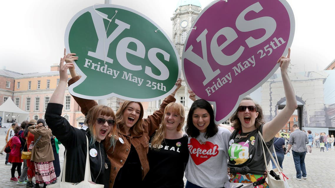 Yes campaigners jubilate as they wait for the official result of the Irish abortion referendum, at Dublin Castle in Dublin on May 26, 2018. The first official results declared in Ireland's historic referendum on its strict abortion laws, showed 60 percent in the Galway East constituency backed repealing the constitutional ban on terminations. (AFP)