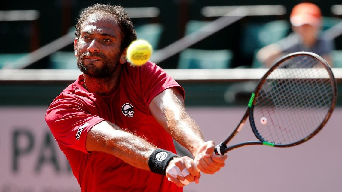 Egypt's Mohamed Safwat in action during the first round against Bulgaria's Grigor Dimitrov. (Reuters)