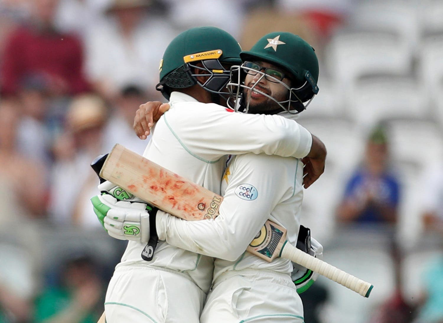 Pakistan's Imam ul-Haq (right) and Haris Sohail celebrate after winning the First Test. (Reuters)