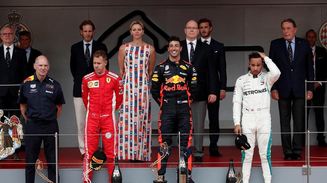 Red Bull's Daniel Ricciardo celebrates winning the race with Ferrari's Sebastian Vettel finishing second, Lewis Hamilton who finished in third while Prince Albert II of Monaco and Charlene, Princess of Monaco look on. (Reuters)