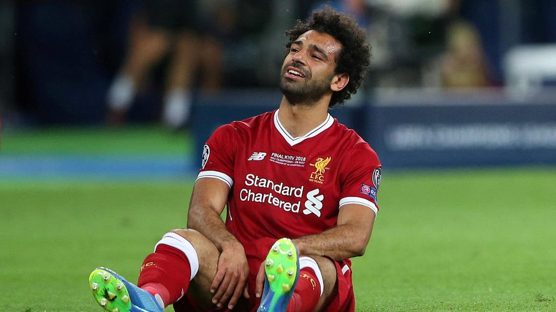 Liverpool's Mohamed Salah looks dejected after sustaining an injury. (Reuters)