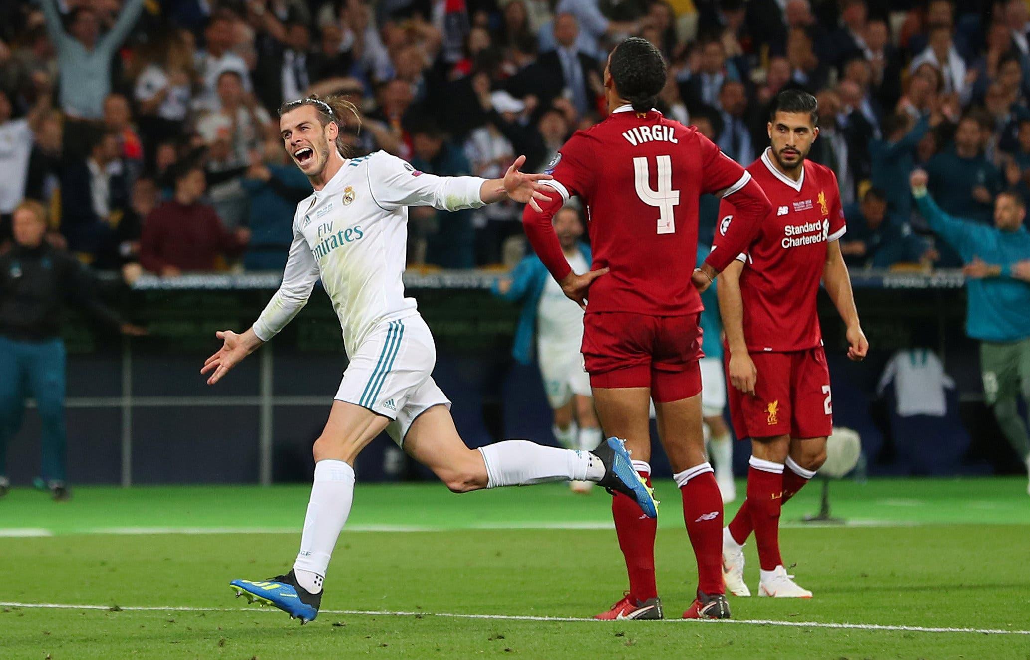 Real Madrid's Gareth Bale celebrates scoring their third goal as Liverpool's Virgil van Dijk and Emre Can look dejected. (Reuters)