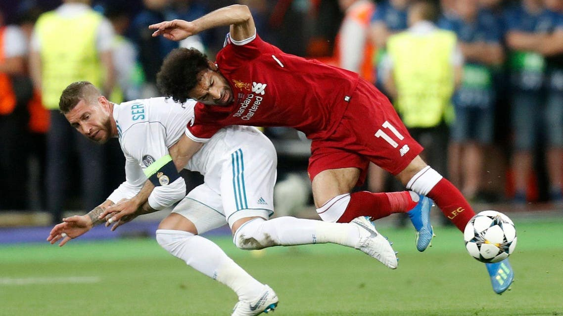 Real Madrid's Sergio Ramos, left, tackles Liverpool's Mohamed Salah during the Champions League Final. (Reuters)