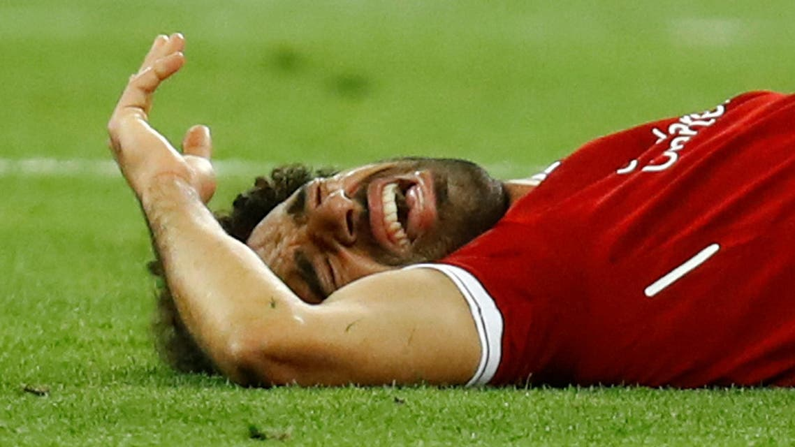 Liverpool's Mohamed Salah reacts after sustaining an injury. (Reuters)