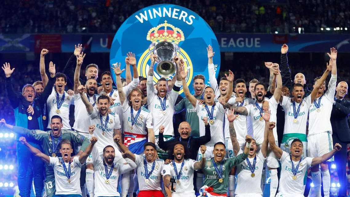Real Madrid celebrate winning the Champions League with the trophy. (Reuters)