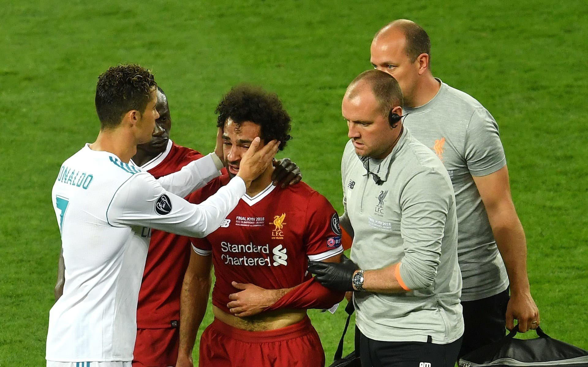 Cristiano Ronaldo comfort Mohamed Salah as he leaves the pitch in tears  Credit: Reuters