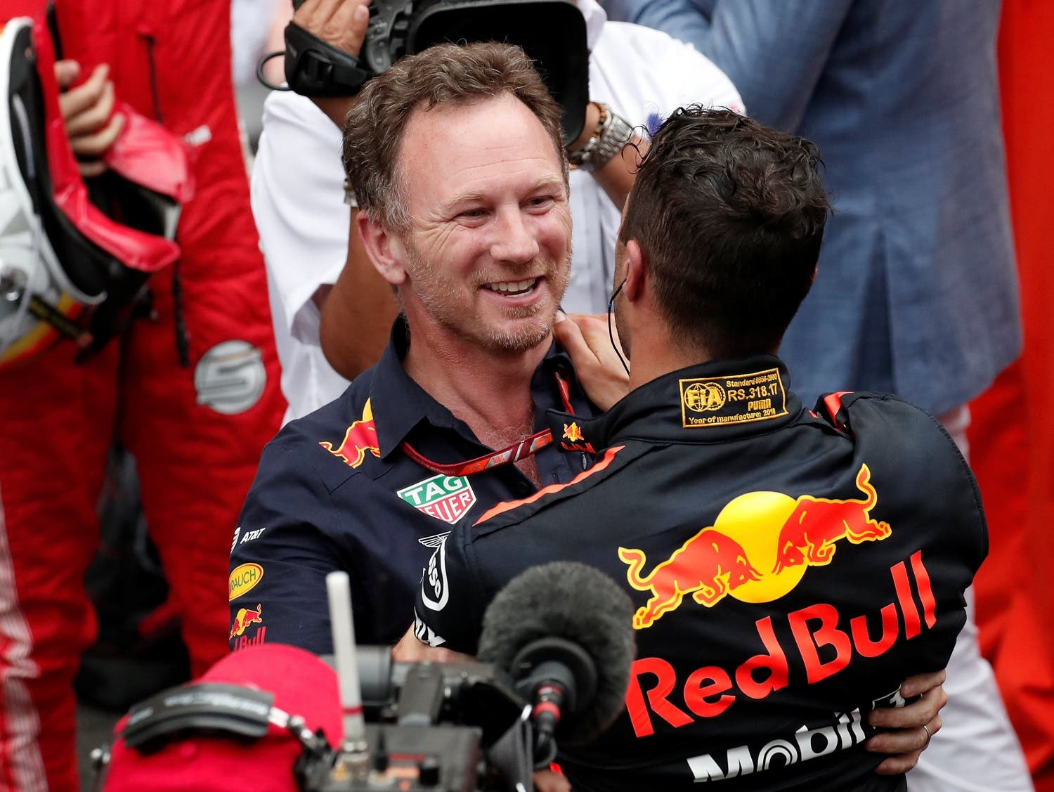 Red Bull's Daniel Ricciardo celebrates winning the race with Red Bull Team Principal Christian Horner (Reuters)